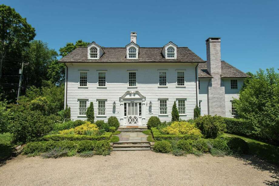 The 18-room antique colonial house at 101 Clapboard Hill Road was spared the wrecking ball by a preservation-minded couple that restored and updated it. Photo: Contributed Photos / © SR Photo, LLC All Rights Reserved