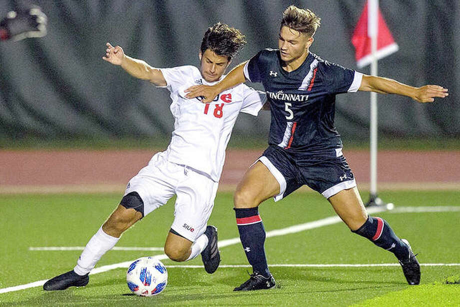 Steven Bibas of SIUE battles Cincinnati's Pascal Igl during action in a preseason game Friday at Korte Stadium. The Cougars, who open the season Friday at Memphis, have been picked by league coaches to finish fourth in the Mid-American Conference race this season. Photo:       SIUE Athletics