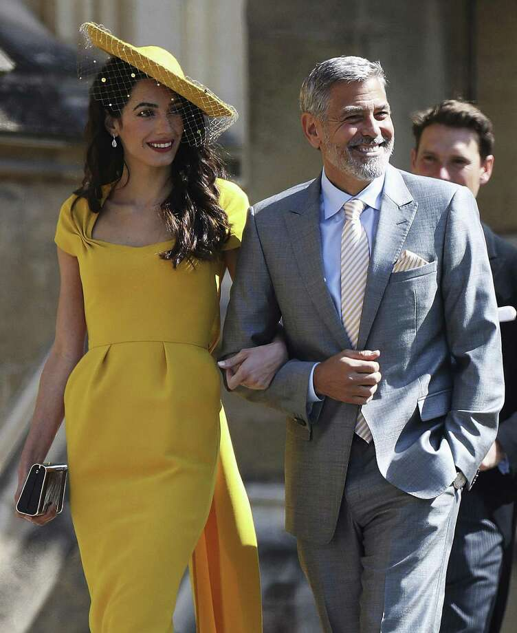 Amal Clooney and George Clooney arrive for the wedding of Prince Harry to Meghan Markle, at St. George's Chapel in Windsor Castle in Windsor, near London, England, Saturday, May 19, 2018. (Chris Jackson/pool photo via AP) Photo: Chris Jackson / Associated Press / WPA Rota