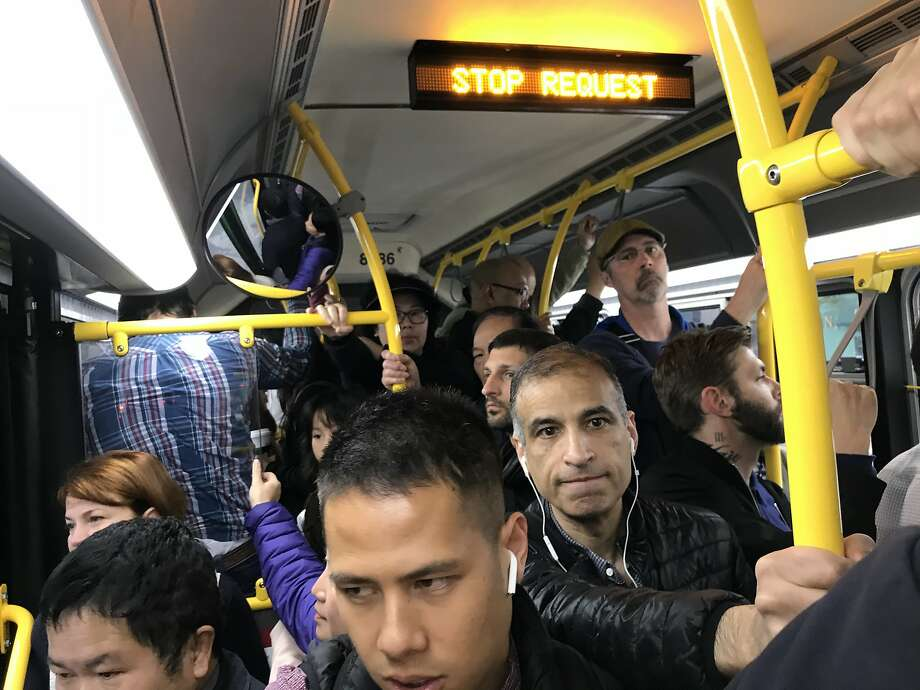 A trash fire on the tracks of San Francisco's Muni subway caused delays the morning of Wednesday, Aug. 22, 2018, and many commuters were diverted onto crowded buses. Photo: Steve Rubenstein / The Chronicle