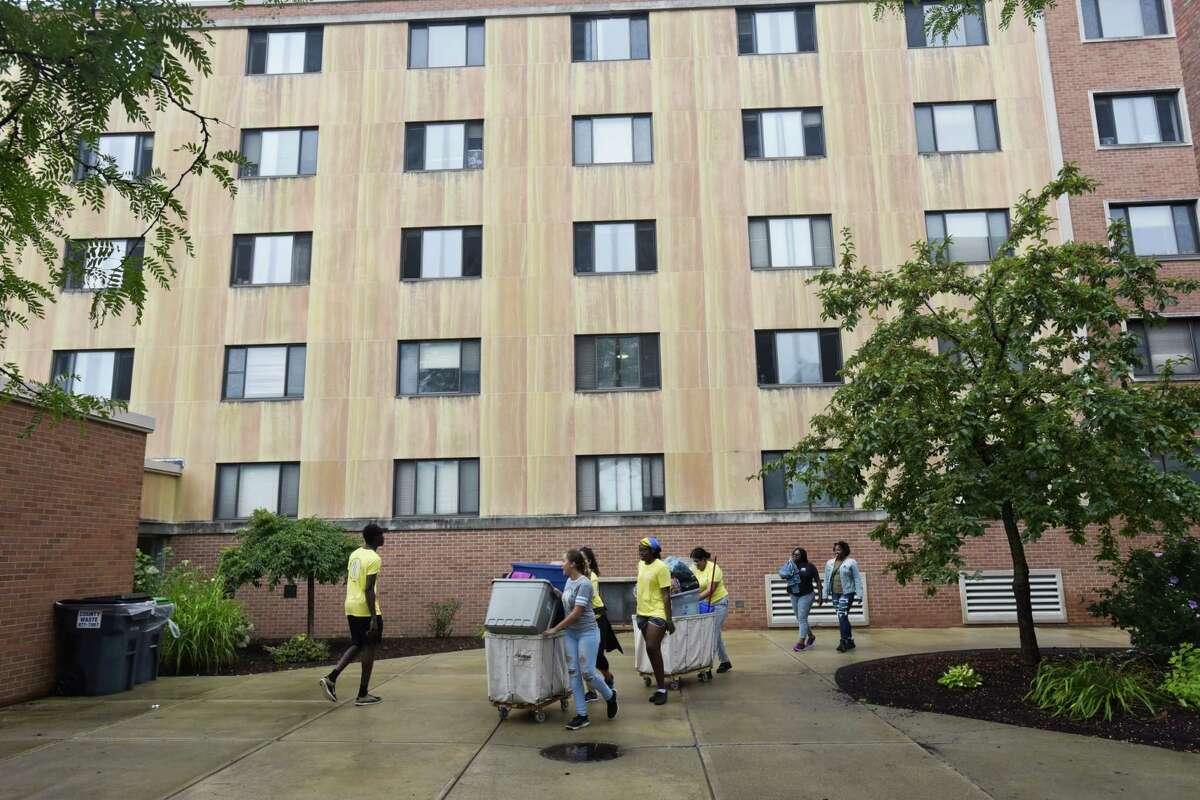 College of Saint Rose students use carts to carry in a new student's belongings during freshman move-in day at the College of Saint Rose on Wednesday, Aug. 22, 2018, in Albany, N.Y. (Paul Buckowski/Times Union)
