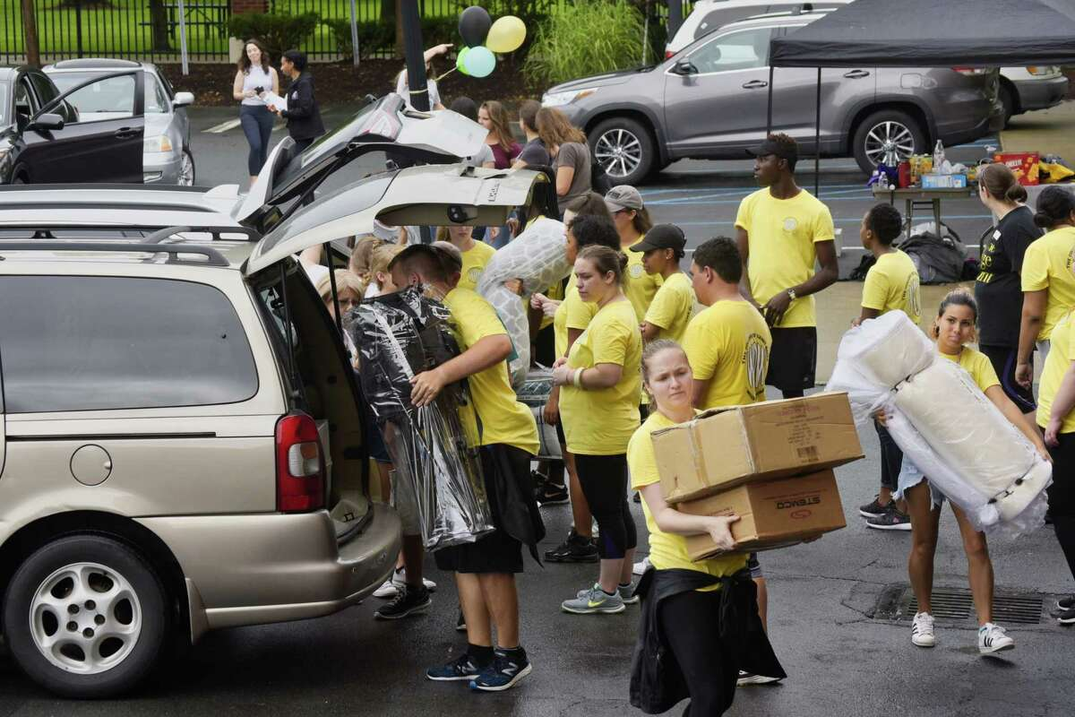 College of Saint Rose students help unload the belongings of new students during freshman move-in day at the College of Saint Rose on Wednesday, Aug. 22, 2018, in Albany, N.Y. (Paul Buckowski/Times Union)