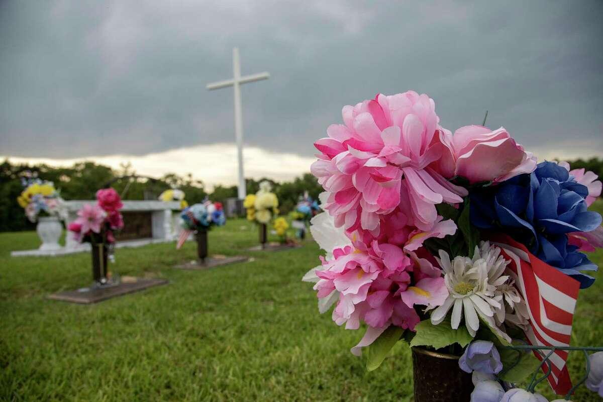 The graves of Saldivar family members killed during Hurricane Harvey, photographed Thursday, Aug. 9, 2018, in Houston.
