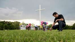 Ric Saldivar visits the graves of his parents and their four great-grandchildren, who drowned in a van during Hurricane Harvey, Thursday, Aug. 9, 2018, in Houston.