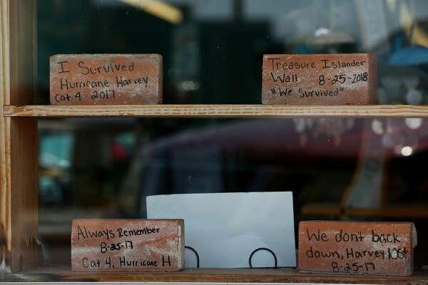 Bricks that fell off a store in Rockport during the storm are now for sale with phrases written on them.