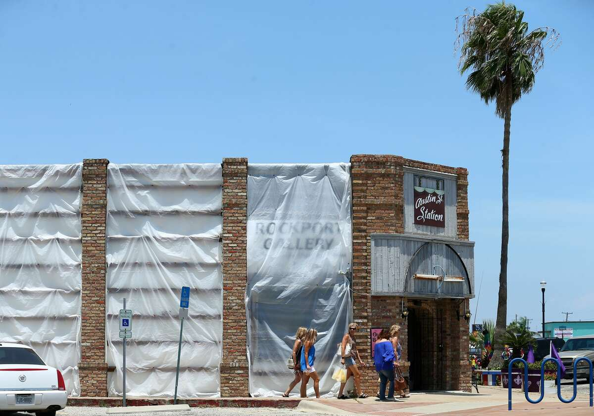 Visitors walk past the ongoing construction in downtown Rockport.