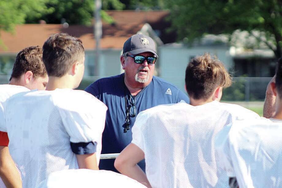 Jersey football coach Ric Johns speaks with players during a summer workout session in Jerseyville. Johns, a longtime area coach at Calhoun, Triad, Belleville West and Wesclin, is beginning his first year at Jersey. Photo:       Pete Hayes   The Telegraph