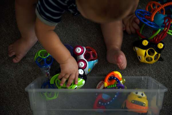 A baby plays with toys at the Monahans Bright Stars LLC daycare center in Monahans, Texas, U.S., on Tuesday, Aug. 21, 2018. More than 1,400 children were on daycare waiting lists in Midland and the surrounding area earlier this year, according to the latest available data. It's a statistic that's keeping both families and communities from taking full financial advantage of the Permian Basin's rise to energy dominance. Photographer: Callaghan O'Hare/Bloomberg