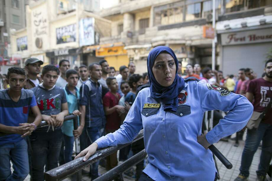 An Egyptian policewoman — part of a security force to combat sexual harassment — patrols the streets of Cairo in 2015. Catcalls, pinching and grabbing are rampant in Egypt. Photo: Roger Anis / Associated Press 2015