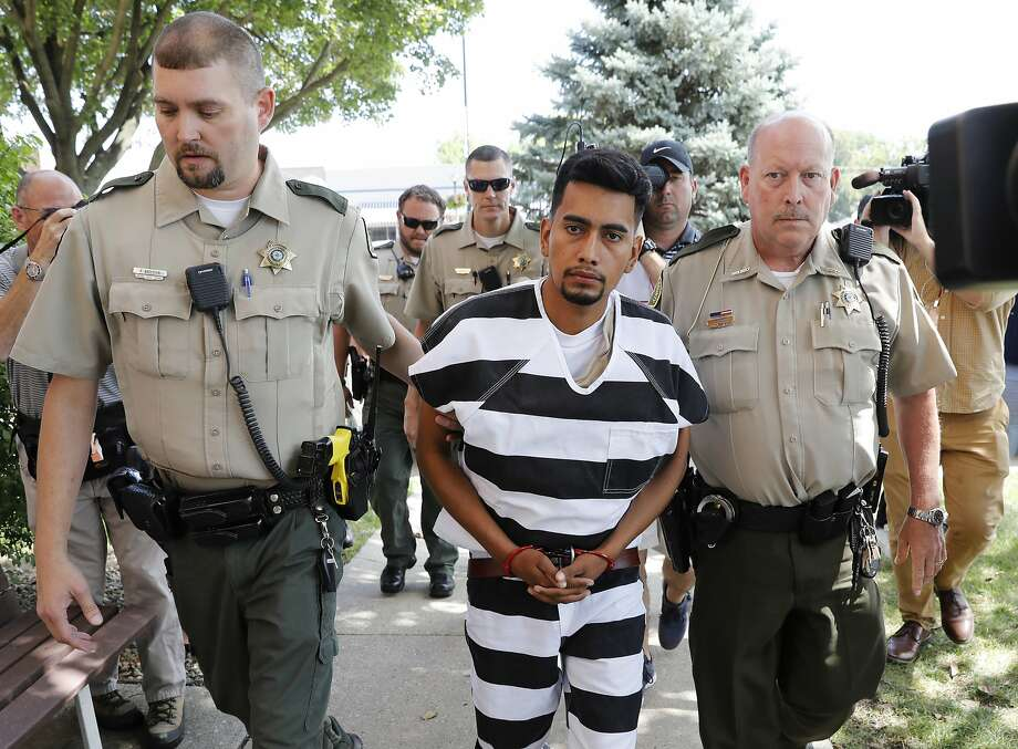 Cristhian Bahena Rivera is escorted into the Poweshiek County Courthouse for his initial court appearance, Wednesday, Aug. 22, 2018, in Montezuma, Iowa. Rivera is charged with first-degree murder in the death of Mollie Tibbetts, who disappeared July 18 from Brooklyn, Iowa. (AP Photo/Charlie Neibergall) Photo: Charlie Neibergall / Associated Press