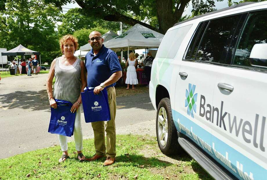 Our exclusive sponsor   Debra Hanson, left, executive director of Wilton Chamber of Commerce, and Tapas Deb, assistant branch manager of Bankwell's Wilton branch, stopped by the weekly farmers market, which Bankwell of Wilton sponsors. Photo: Contributed Photo / Contributed Photo / Norwalk Hour contributed