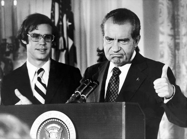 Richard Nixon bids goodbye to the personnel of the White House, standing with his son-in-law David Eisenhower on Aug. 12, 1974. The Watergate scandal, which consisted in the Republican Party's spying on the Democratic Party, was uncovered in 1972.