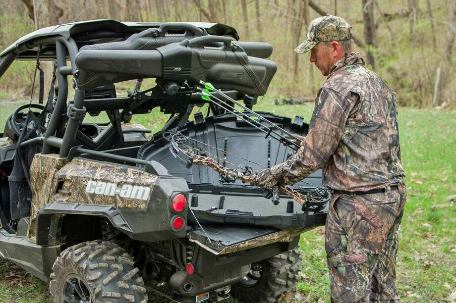 This hunter is ready for opening day with his Can-Am all-terrain vehicle and archery equipment ready. Photo: Howard Communications / Howard Communications http://www.howardcommunications.com
