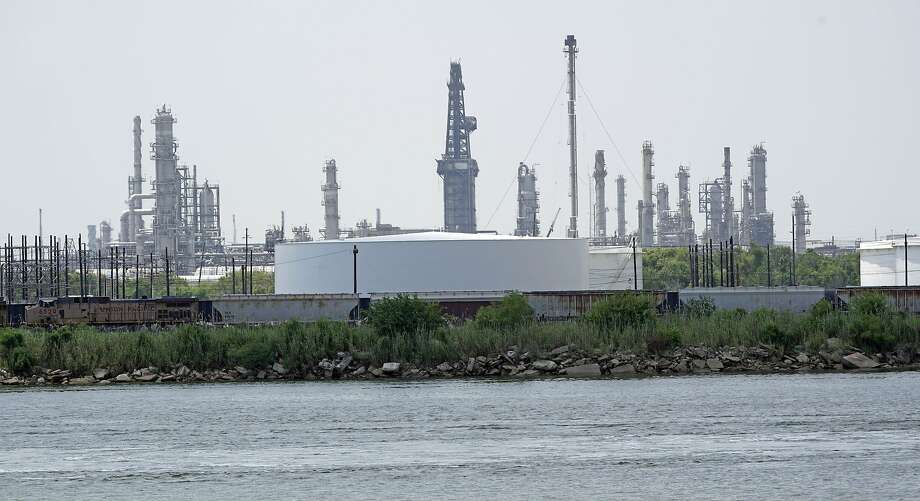 Storage tanks at a refinery along the waterway are shown Thursday, July 26, 2018, in Port Arthur, Texas. Photo: David J. Phillip, Associated Press