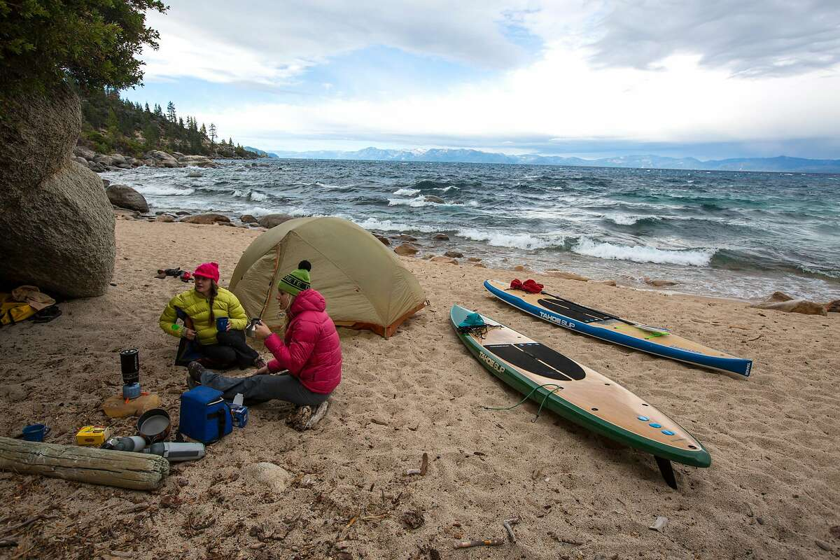 Amie Engerbretson and Lauren Bobowski hunker down onshore during an attempt to circumnavigate Lake Tahoe in the fall.
