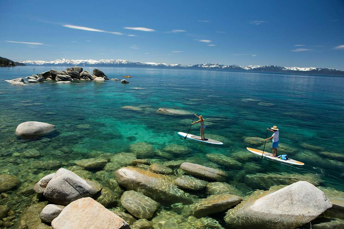 Dustin Schaad and Amie Engerbretson paddle the clear waters of Lake Tahoe's East Shore in springtime.