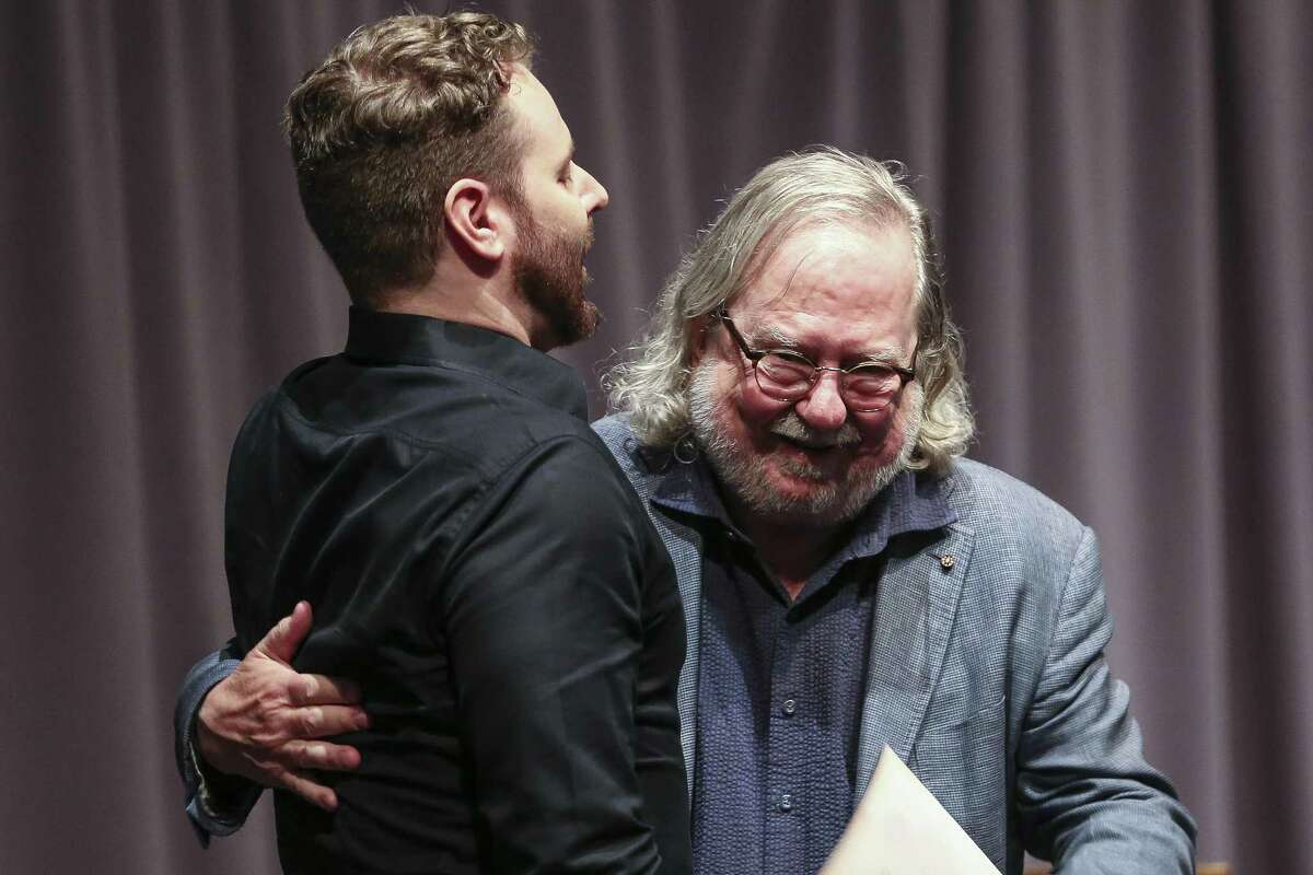 Immunologist Dr. Jim Allison, right, gets a hug from Sean Parker, founder of Napster and Facebook and the Parker Center for Cancer Immunotherapy, during a Celebration of Cancer Immunotherapy and Jim Allison at MD Anderson on Aug. 3, 2018 in Houston.