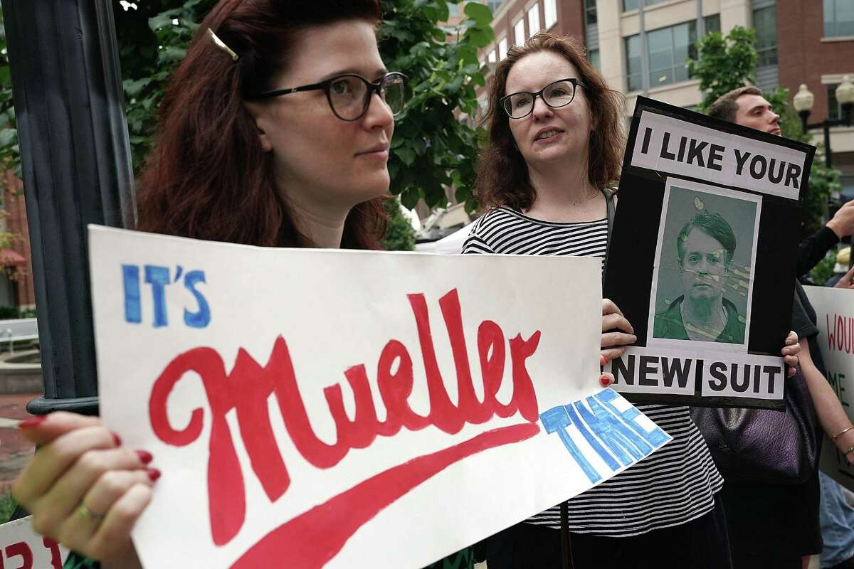 ALEXANDRIA, VA - JULY 31: Activists hold signs during a protest outside the Albert V. Bryan United States Courthouse prior to the first day of the trial of former Trump campaign chairman Paul Manafort July 31, 2018 in Alexandria, Virginia. Manafort was charged with financial frauds and is the first defendant in special counsel Robert Mueller's investigation into Russian interference in the 2016 presidential election to face trial. (Photo by Alex Wong/Getty Images)