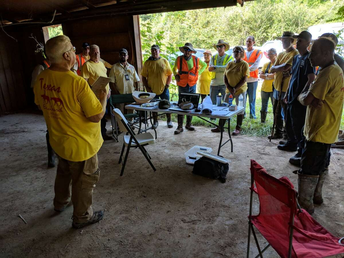 Searchers gather to help find a missing elderly woman Wednesday, Aug. 22, 2018. The woman was eventually found safe.