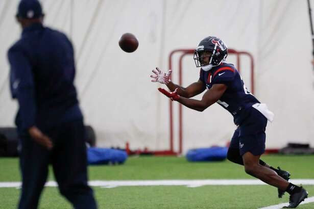 Houston Texans running back Tyler Ervin reaches out to catch a pass while running a drill during training camp at the Methodist Training Center on Wednesday, Aug. 22, 2018, in Houston.