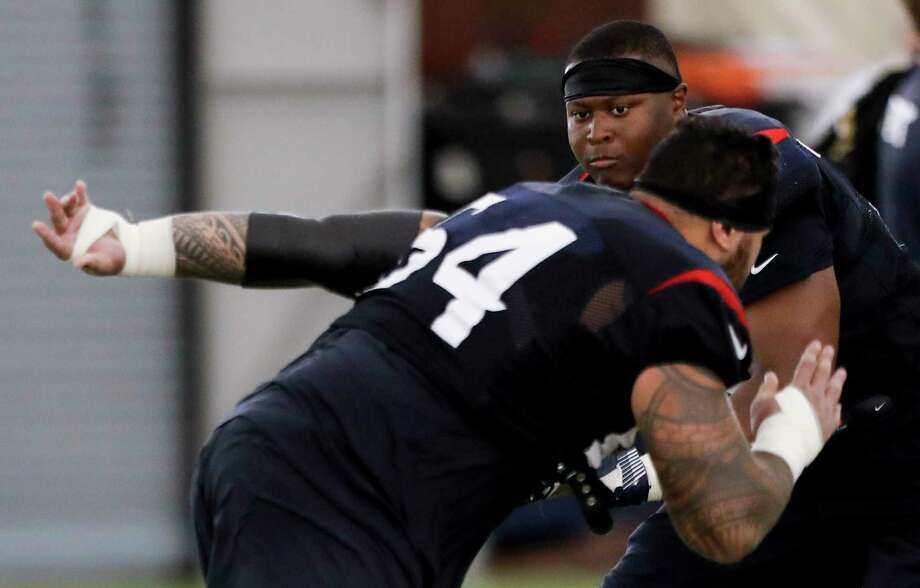 Houston Texans guard Senio Kelemete (64) and offensive tackle Martinas Rankin (75) work extra after practice during training camp at the Methodist Training Center on Wednesday, Aug. 22, 2018, in Houston. Photo: Brett Coomer, Staff Photographer / © 2018 Houston Chronicle