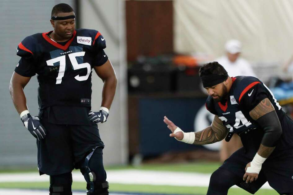 Houston Texans offensive tackle Martinas Rankin (75) and guard Senio Kelemete (64) work extra after practice during training camp at the Methodist Training Center on Wednesday, Aug. 22, 2018, in Houston.