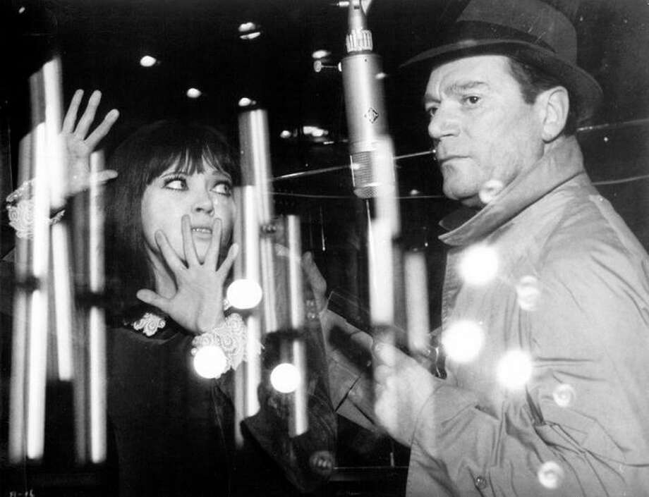 "Anna Karina and Eddie Constantine star in Jean-Luc Godard's ""Alphaville."" Photo: Criterion Collection 1965"