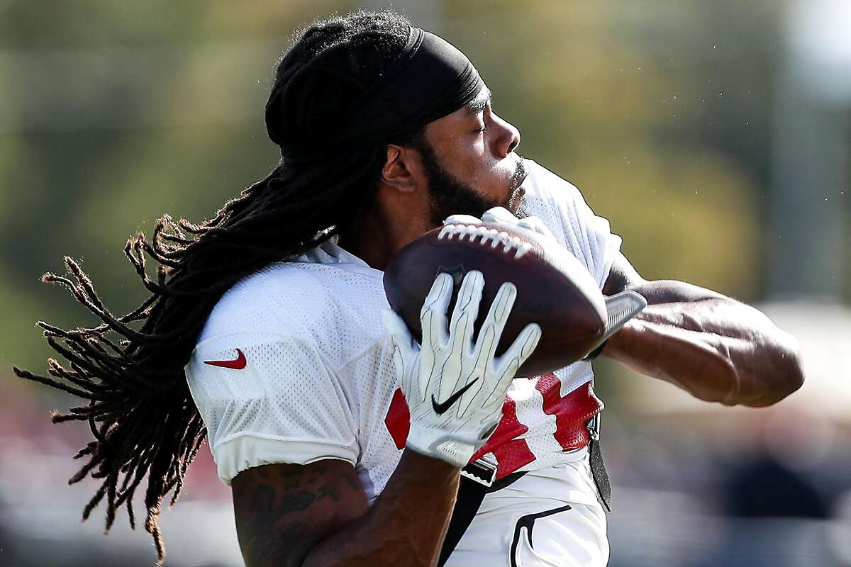 San Francisco 49ers defensive back Richard Sherman (25) catches a football as he runs a drill during a joint practice between the Houston Texans and the 49ers at the Methodist Training Center on Thursday, Aug. 16, 2018, in Houston.