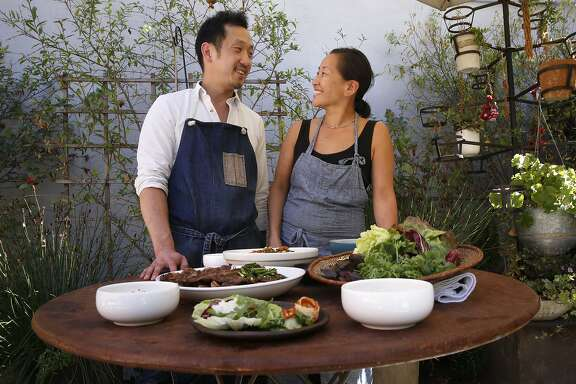 Chefs Steve Joo  and Julya Shin are the owners of a Korean ssam pop-up called Nokni, as seen on Mon. Sept.. 25, 2017, in Oakland, Ca. The chefs show how to put together the dishes for a ssam party.