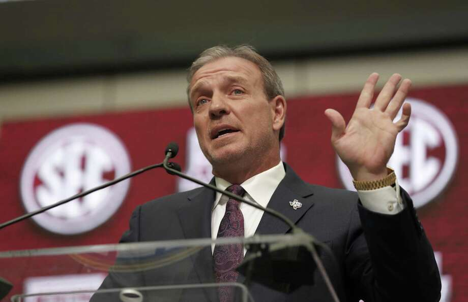 In this July 16, 2018, file photo, Texas A&M head coach Jimbo Fisher speaks at Southeastern Conference Media Days in Atlanta. Texas A&M handed Fisher a 10-year, $75 million contract to leave Florida State after Kevin Sumlin was fired last year. Aggie fans believe that's 75 million reasons why he should be the one to deliver their first national title since 1939. He knew what the expectations were before the ink was dry on the deal. And he insists he isn't daunted by them. Photo: John Bazemore, STF / Associated Press / Copyright 2018 The Associated Press. All rights reserved.