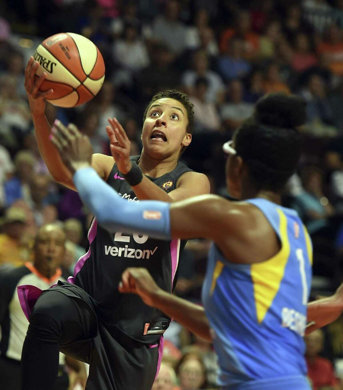 Connecticut Sun guard Layshia Clarendon, left, drives to the basket as Chicago Sky guard Diamon DeShields defends in the second half on Aug. 12.