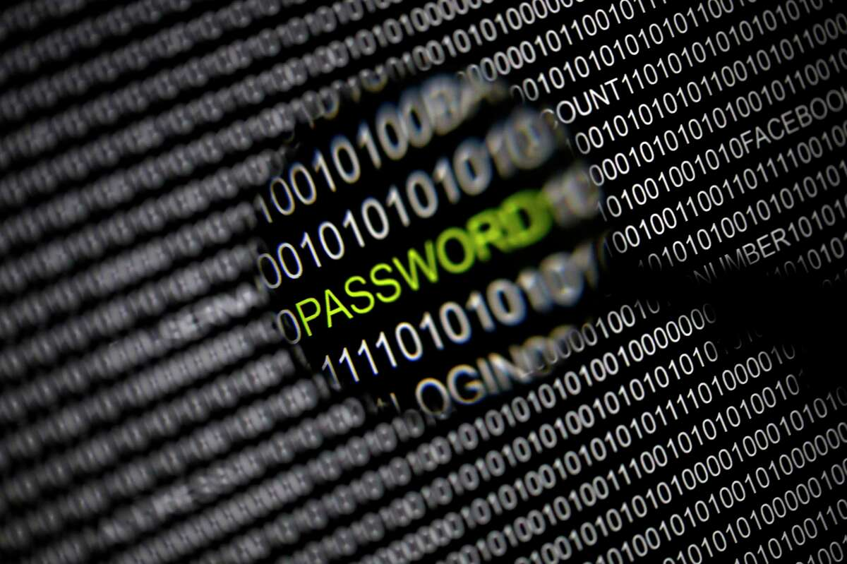 """File picture illustration of the word 'password' pictured through a magnifying glass on a computer screen, taken in Berlin May 21, 2013. Security experts warn there is little Internet users can do to protect themselves from the recently uncovered """"Heartbleed"""" bug that exposes data to hackers, at least not until vulnerable websites upgrade their software. Researchers have observed April 8, 2014, sophisticated hacking groups conducting automated scans of the Internet in search of Web servers running a widely used Web encryption program known as OpenSSL that makes them vulnerable to the theft of data, including passwords, confidential communications and credit card numbers. OpenSSL is used on about two-thirds of all Web servers, but the issue has gone undetected for about two years. REUTERS/Pawel Kopczynski/Files (GERMANY - Tags: CRIME LAW SCIENCE TECHNOLOGY)"""