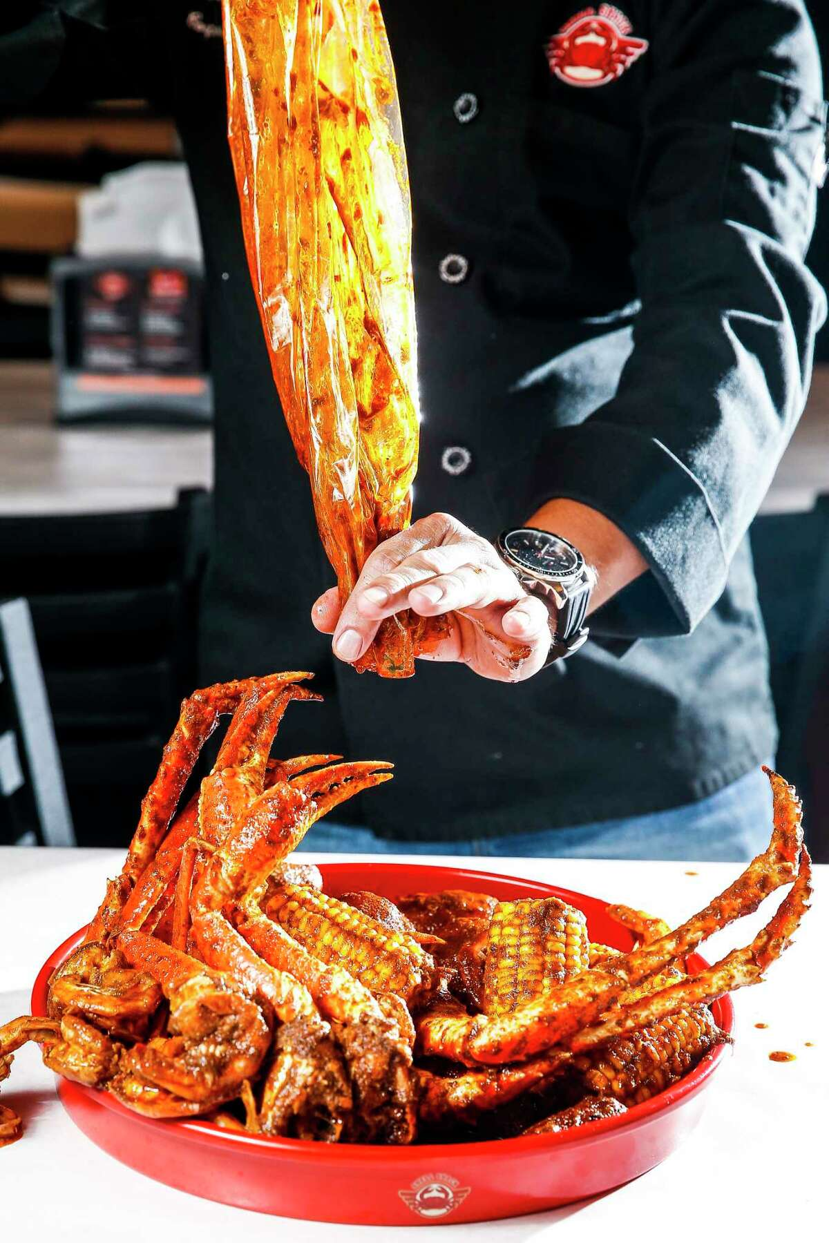The Date Night platter at Dallas-based Shell Shack's new location on Washington Avenue has one pound of snow crab, one pound of boiled shrimp, one pound of king crab, four pieces of corn, six potatoes and six pieces of sausage. The seafood dinner is brought to the table in a seasoning bag.