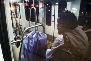 After finishing his work shift near midnight, Jahvuon King-Registe rides the Light Rail Wednesday, June 13, 2018, in Houston on his way to the TSU/UH Athletic District stop where he meets his mother and together they drive to their home located in Pearland. (Marie D. De Jesus | Houston Chronicle)