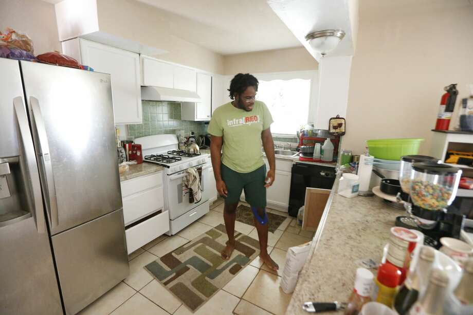 University of Houston student Jahvuon King-Registe's once flood damaged home is beginning to look like home Wednesday, April 11, 2018, in Pearland. His beloved posters have returned to his walls and his computer is up and running which is bring some sort of normalcy to his life since Hurricane Harvey severely damaged it. Photo: Steve Gonzales