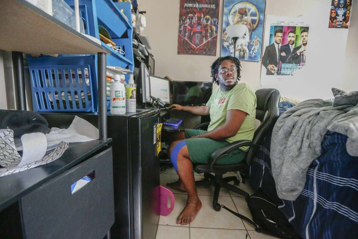 University of Houston student Jahvuon King-Registe's flood damaged home is beginning to look like home Wednesday, April 11, 2018, in Pearland. His beloved posters have returned to his walls and his computer is up and running which is bringing some sort of normalcy to his life since Hurricane Harvey severely damaged it.