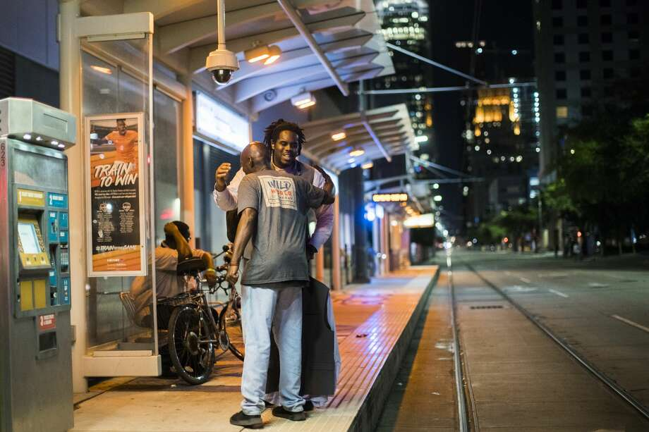 As Jahvuon King-Registe wait for the Light Rail to arrive, he gets an embrace from a man who approach him asking for  change at the Convention District stop, Wednesday, June 13, 2018, in Houston. (Marie D. De Jesus| Houston Chronicle)