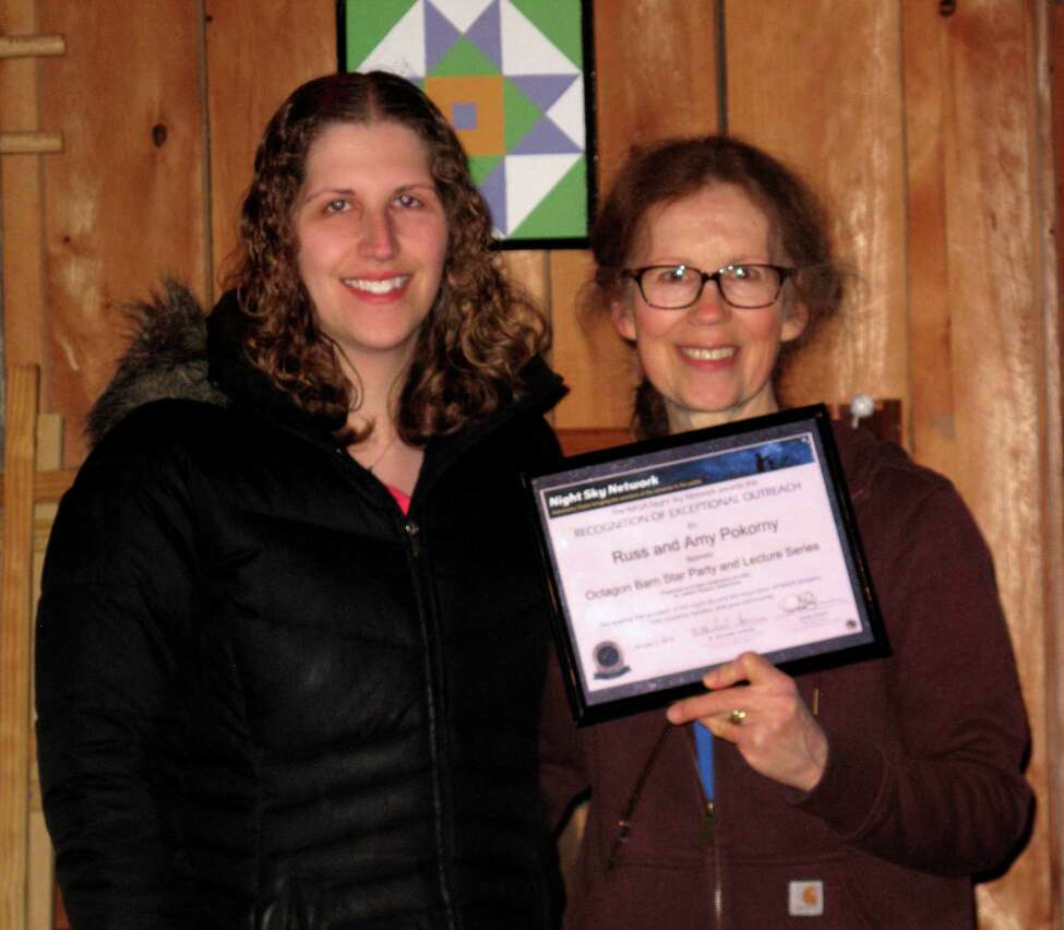 Dudley Observatory's astronomer Valerie Rapson (left) nominated Knox retirees Amy (right) and Russ Pokorny for a NASA award shown here. The award honors the couple for increasing interest in astronomy. They host monthly Star Parties in the beautiful Octagon Barn they built on their property. Dudley supplies the telescopes.