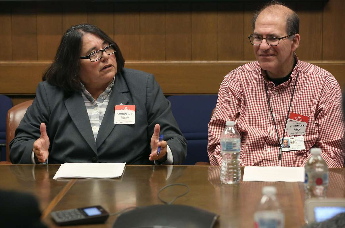 Barbara Garcia, (left) and director of public health Dr. Barry Zevin (right) discuss the city's opioid epidemic at the Chronicle on Wednesday, October 25, 2017, in San Francisco, Calif.