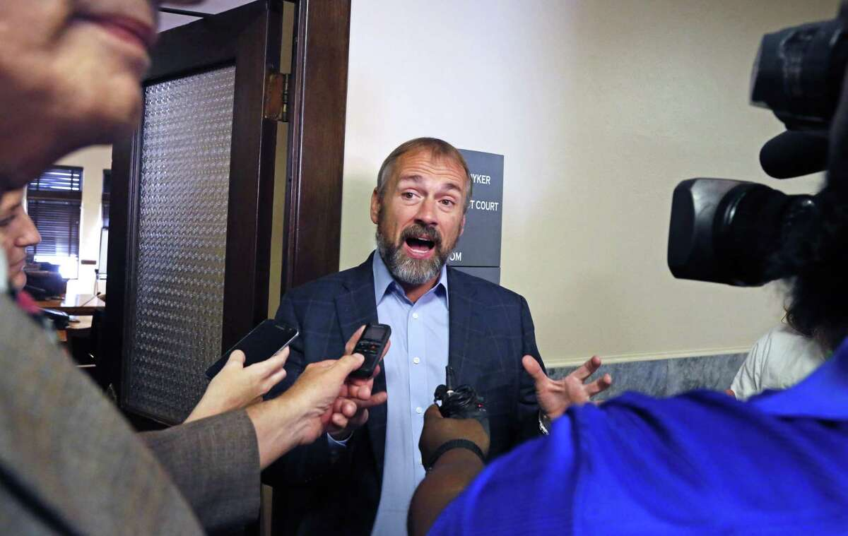 Christian Archer, campaign manager for Secure San Antonio meets with the press after the proceedings on Wednesday, Aug.15, 2018. The Secure San Antonio's Future PAC will be in court to argue that a judge should toss out the petitions filed by the local fire union because, the PAC alleges, the fire union illegally funded the petition campaign.