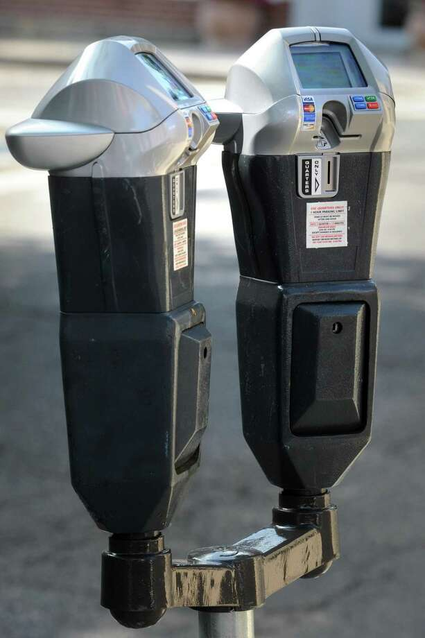 The City of Bridgeport began installing replacement parking meters on downtown streets Wednesday, Aug. 22, 2018. Photo: Ned Gerard / Hearst Connecticut Media / Connecticut Post