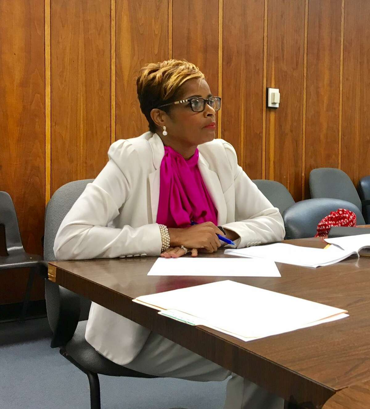 Bridgeport Schools Superintendent Aresta Johnson listens as school board members take turns critiquing her during an open evaluation session. August 21, 2018