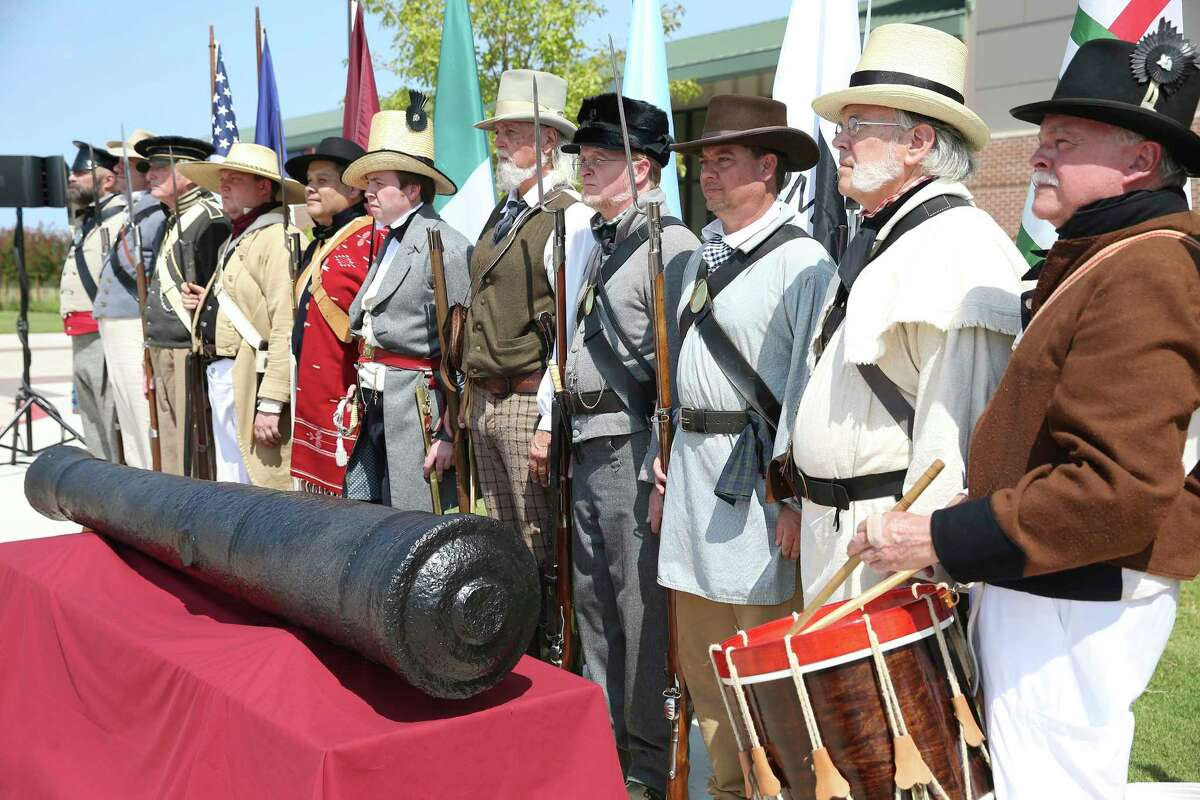 Soldiers dressed in 1830's uniform guard the 16 inch weapon featured as Texas A&M and the Alamo present