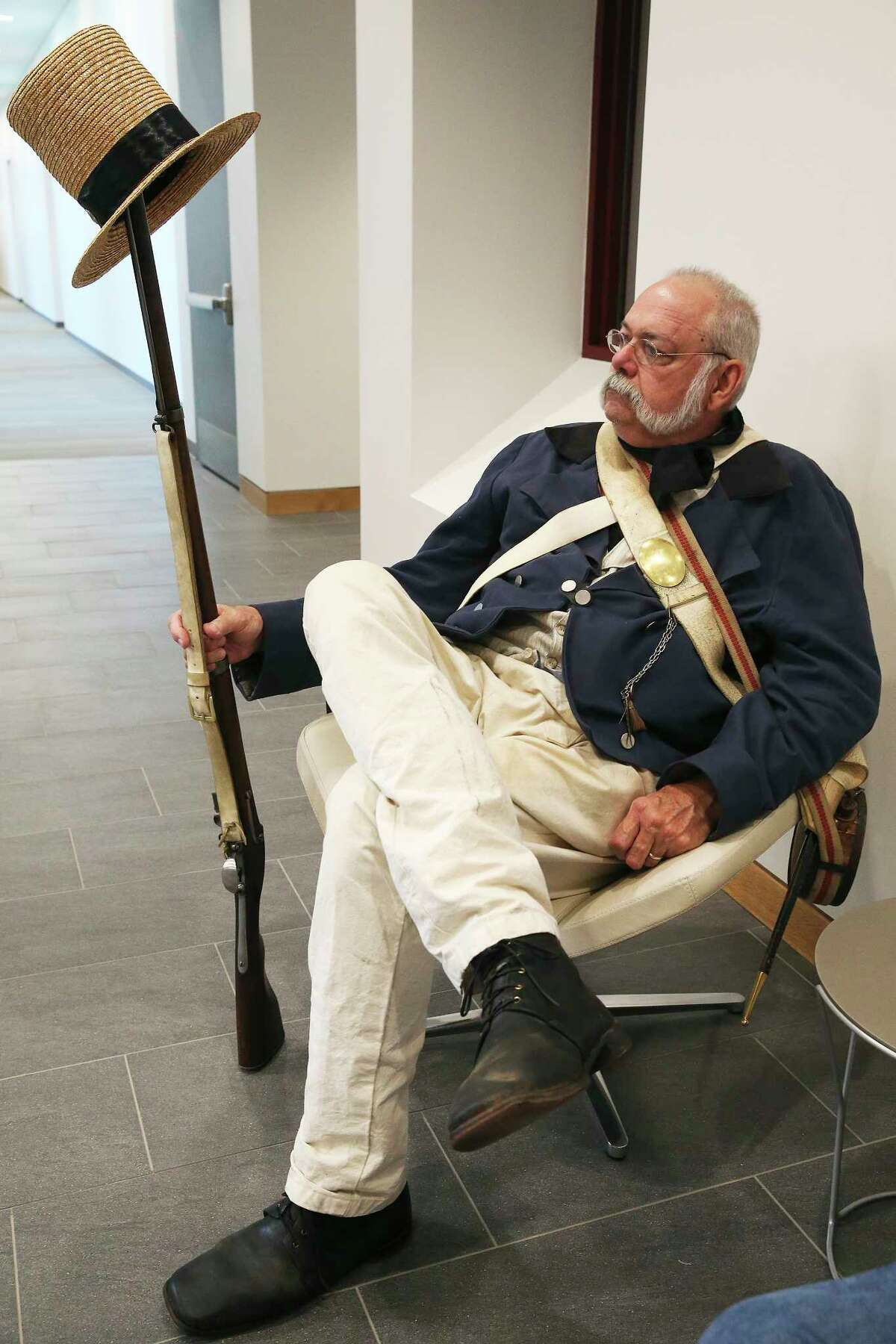 Kent Palma, with the Alamo Living Historians, waits with his gear as Texas A&M and the Alamo present