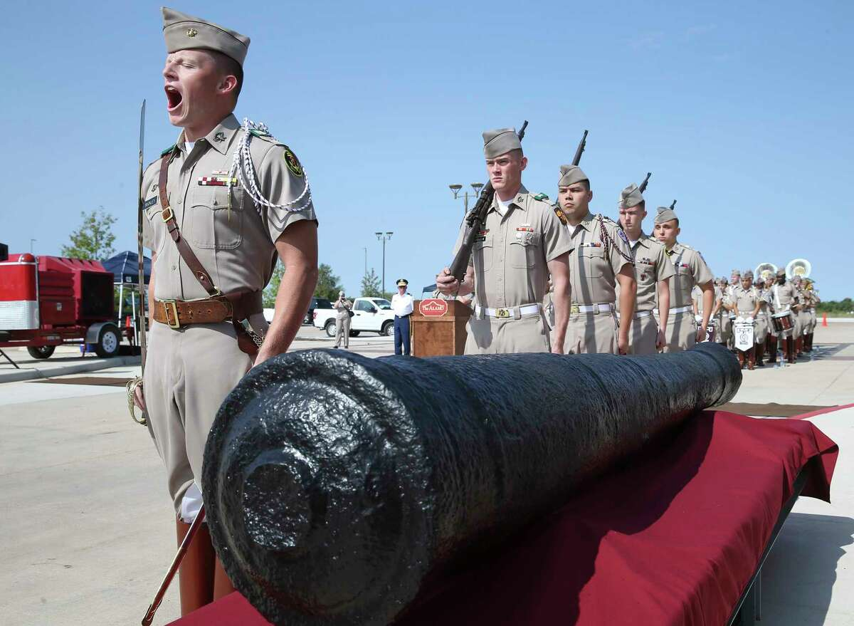 The Corps of Cadets marches in to guard the artifact as Texas A&M and the Alamo present