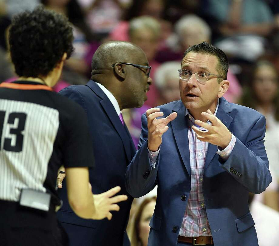 Connecticut Sun head coach Curt Miller, right, argues a call with official Cheryl Flores during the first half of a game against the Las Vegas Aces on Aug. 5 in Uncasville. Photo: Sean D. Elliot / Associated Press / 2018 The Day Publishing Company