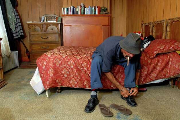 "Samuel ""Poppy"" Baez ties his shoes as he prepares to go for a walk on Tuesday, Aug. 11, 2009, at his apartment in Albany, N.Y. (Cindy Schultz / Times Union) Photo: CINDY SCHULTZ"