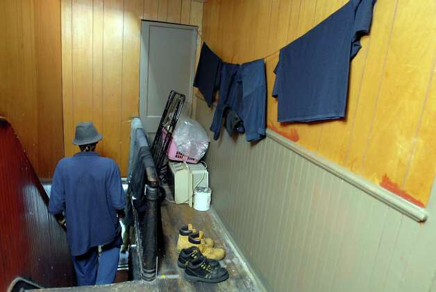 "Samuel ""Poppy"" Baez walks past his laundry line on his way down the stairs on Tuesday, Aug. 11, 2009, at his apartment in Albany, N.Y. (Cindy Schultz / Times Union) Photo: CINDY SCHULTZ"