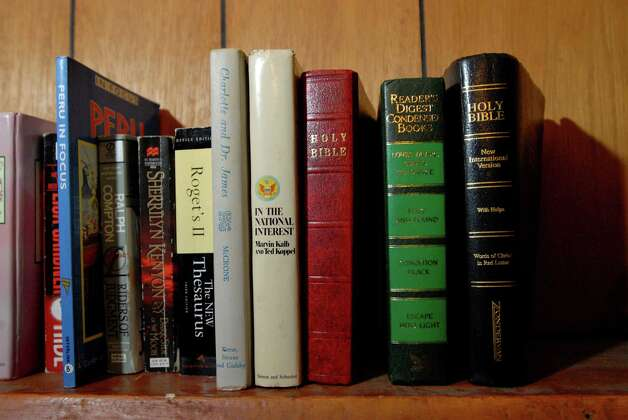 "Samuel ""Poppy"" Baez has books on display in his bedroom on July 24, 2009, at his apartment on Delaware Street in Albany, N.Y. (Cindy Schultz / Times Union) Photo: CINDY SCHULTZ"