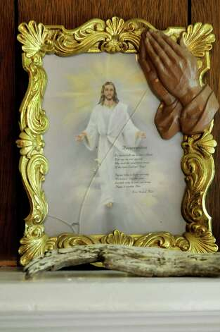 "Samuel ""Poppy"" Baez keeps a framed picture of Jesus Christ with a poem entitled ""Resurrection"" on July 24, 2009, at his apartment on Delaware Street in Albany, N.Y. (Cindy Schultz / Times Union) Photo: CINDY SCHULTZ"